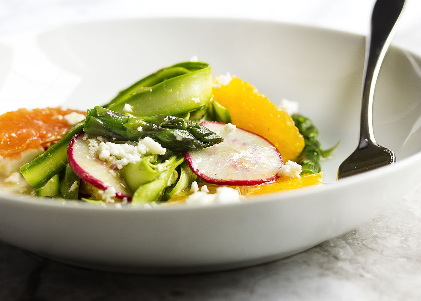 Shaved Asparagus and Orange Salad - Looking for something a little different to do with asparagus? Bored with your usual salad routine? Shaved asparagus salad is great and fun way to use asparagus with sweet oranges and spicy radishes all tossed with an orange vinaigrette.   justalittlebitofbacon.com
