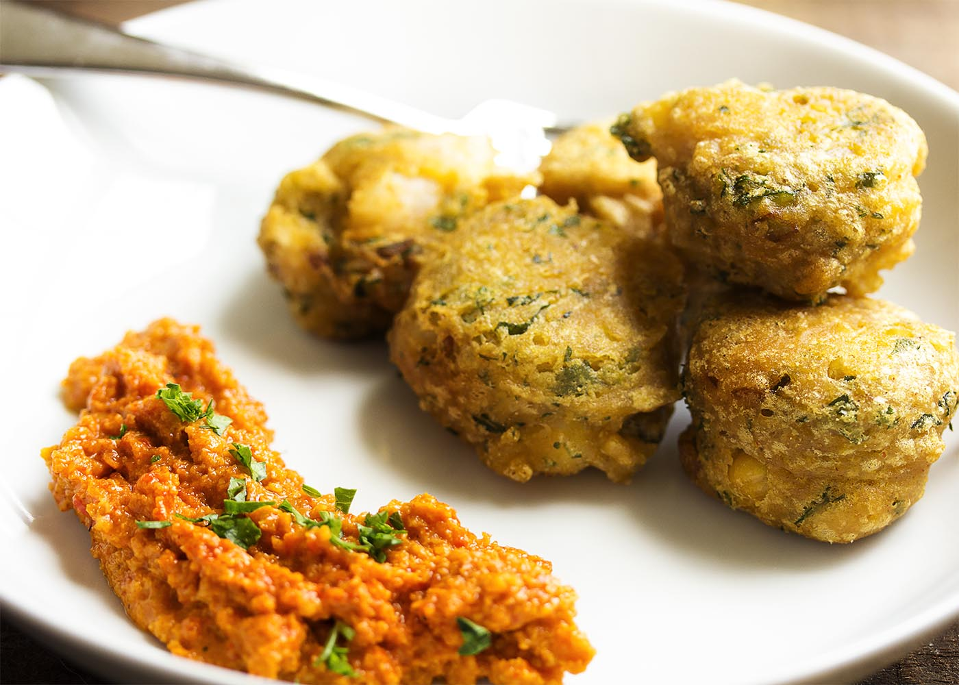 Gluten Free Chickpea Shrimp Fritters - These light and crispy fritters of chickpea flour and chopped shrimp are quickly fried to make a tasty and gluten free appetizer. The recipe includes a vegan option too!   justalittlebitofbacon.com