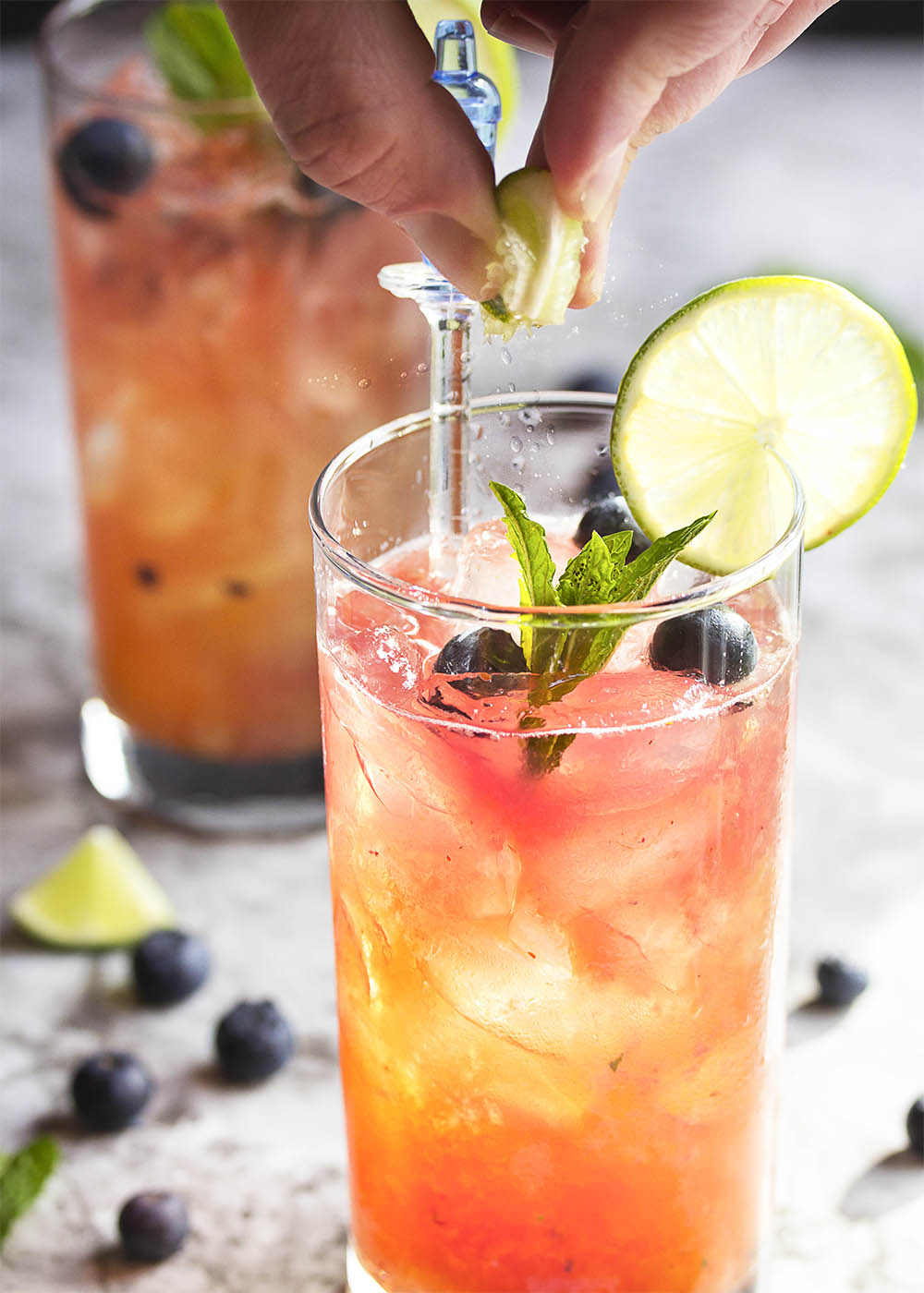 Fresh Blueberry Mojito - This blueberry mojito is full of fresh blueberry and mint flavor, and is an easy and refreshing summer drink perfect for sipping out of a straw. Great for cookouts or a warm evening on your deck!   justalittlebitofbacon.com