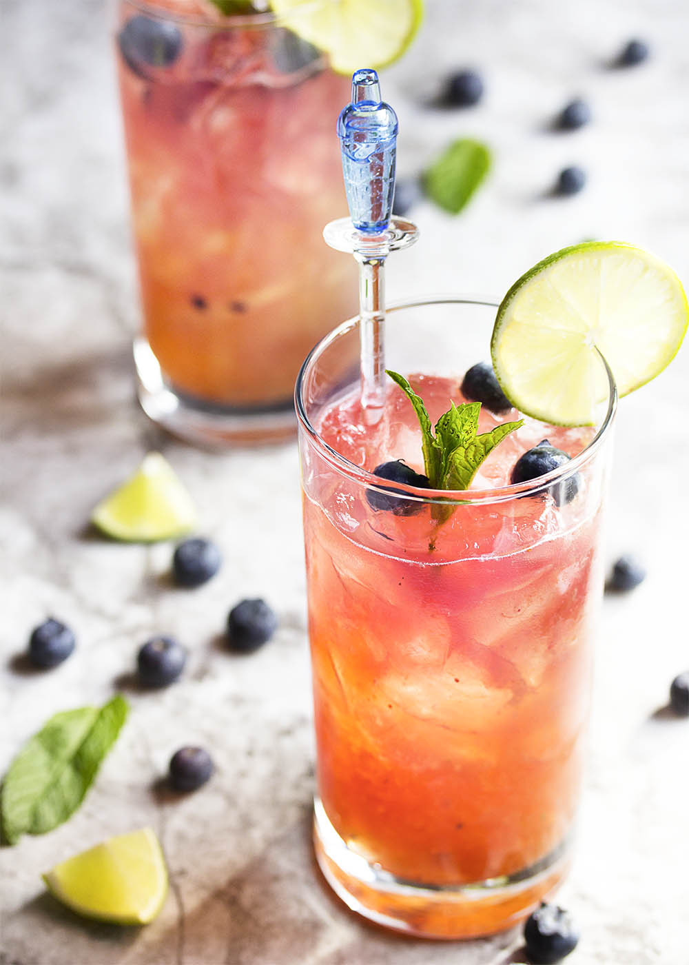 Fresh Blueberry Mojito - This blueberry mojito is full of fresh blueberry and mint flavor, and is an easy and refreshing summer drink perfect for sipping out of a straw. Great for cookouts or a warm evening on your deck! | justalittlebitofbacon.com