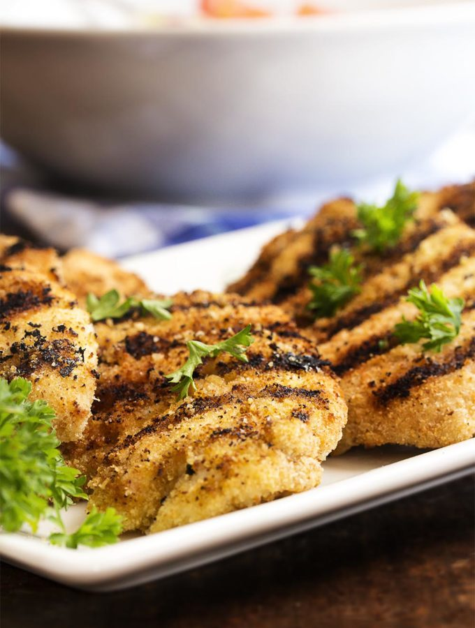 Grilled Breaded Chicken Breast - This recipe has one simple secret that makes juicy and tender grilled boneless chicken breast. So simple, so easy, and so good. | justalittlebitofbacon.com