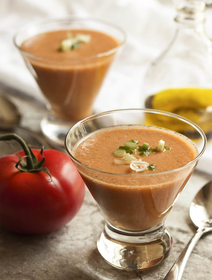 Smooth Tomato Gazpacho - Fresh, ripe, and juicy summer tomatoes and crisp cucumbers make a yummy gazpacho in this easy, no-cook cold soup perfect for a hot day. | justalittlebitofbacon.com