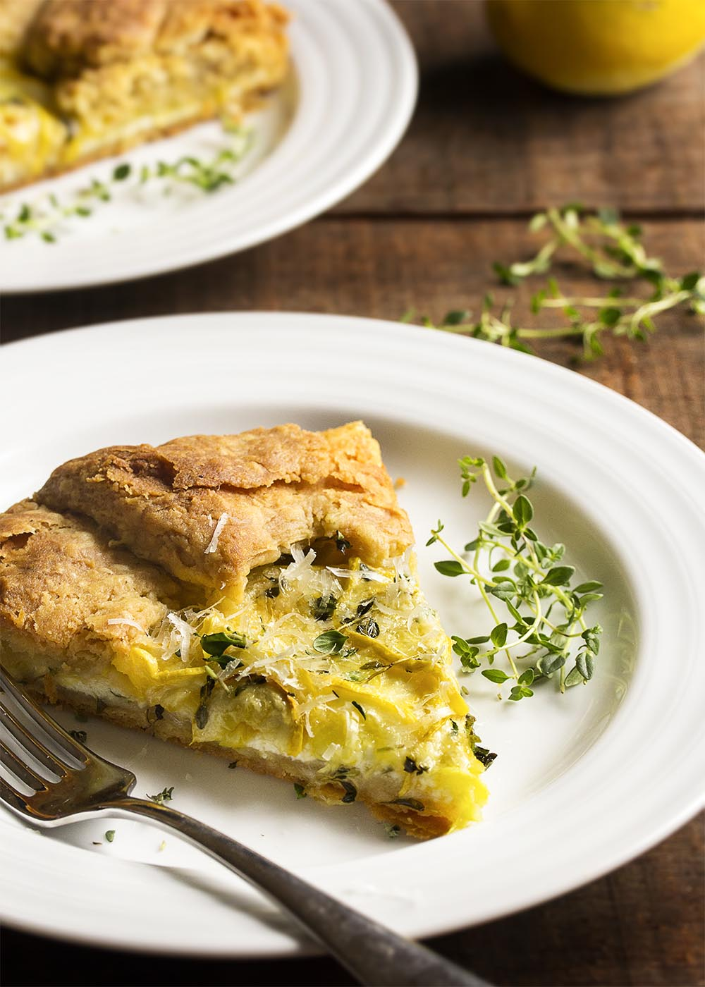Summer Squash and Ricotta Crostata - This summer squash and ricotta crostata is a great Italian free-form tart that makes the most of summer produce. Can be made ahead and is great warm or at room temperature! | justalittlebitofbacon.com