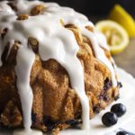 Blueberry Yogurt Cake - This bundt cake is full of fresh blueberries, layers of lemon flavor, and yogurt to make the cake so moist and tender. Great for a summer party, get-together, or just because you couldn't resist buying blueberries at the market. | justalittlebitofbacon.com