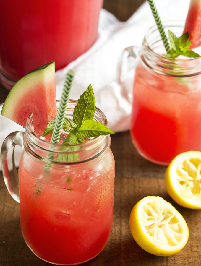 Watermelon Mint Lemonade - Watermelon mixed with lemonade and spiked with mint syrup is a wonderfully refreshing summer beverage, perfect for any hot day. Have it as is, or spike it with a shot of rum for a boozy version. | justalittlebitofbacon.com