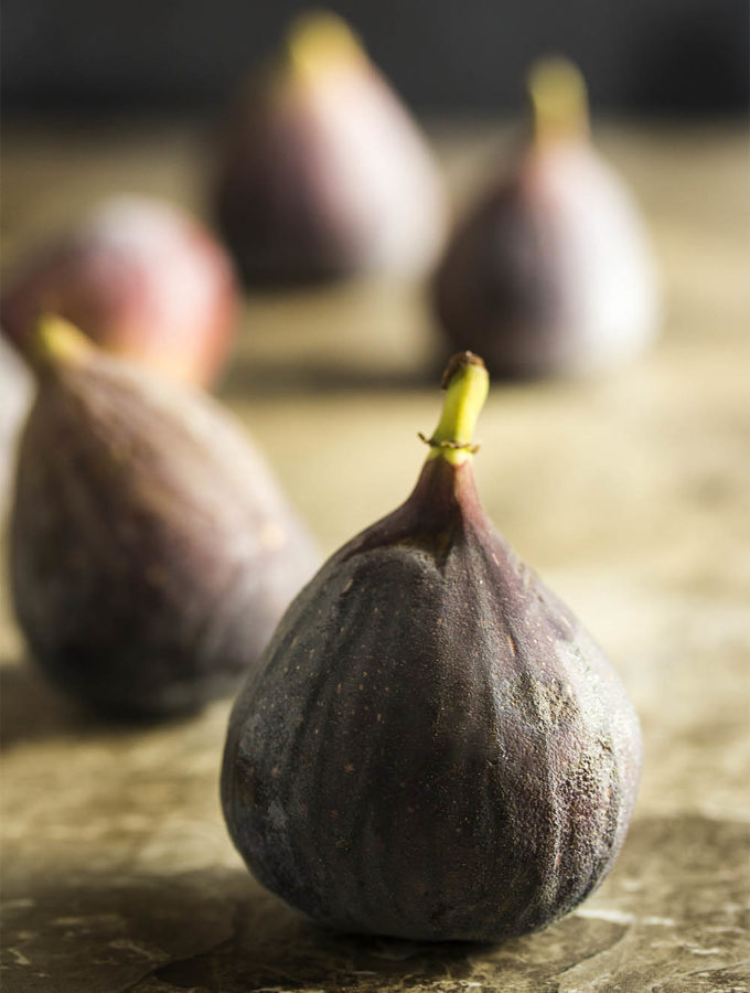Sweet, soft, and juicy fresh figs are great in both sweet and savory dishes. Check out this ingredient spotlight to learn all about them! | justalittlebitofbacon.com