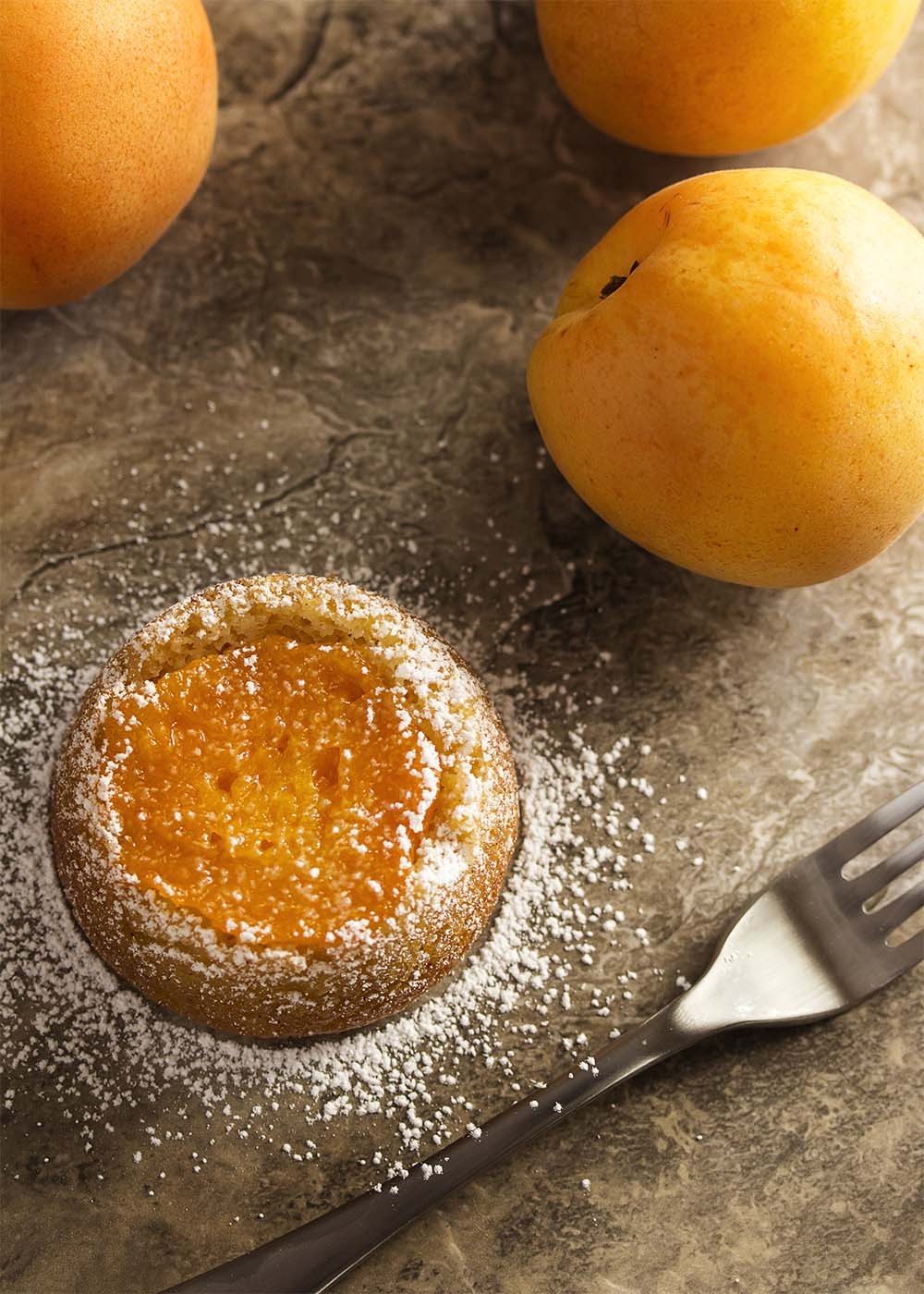 Gluten-free mini upside down cakes are moist and tender from the apricot jam and almond flour, then finished with a slice of apricot. | justalittlebitofbacon.com