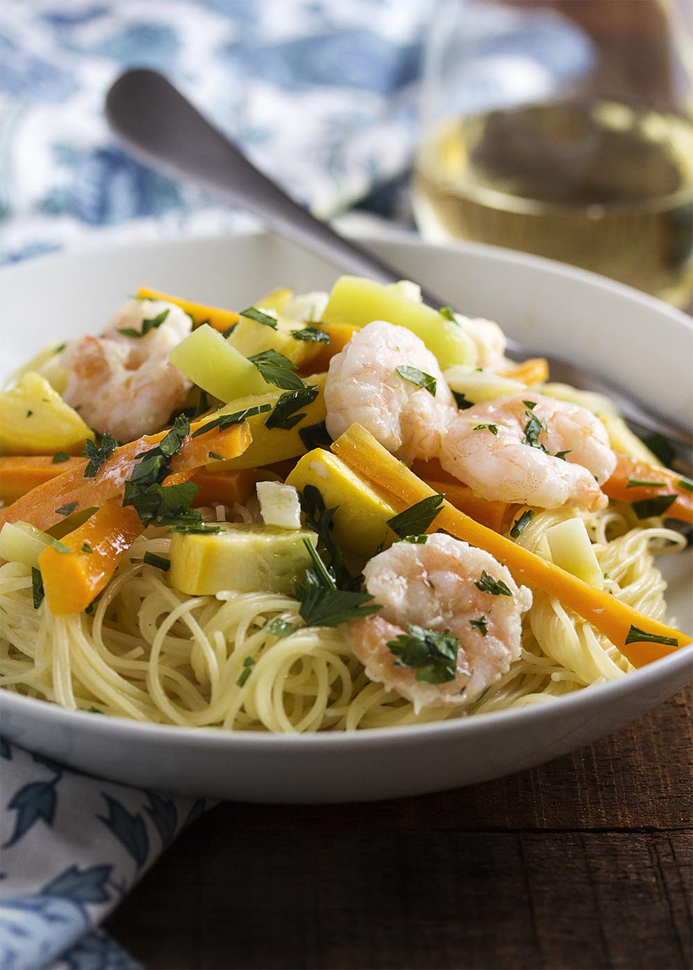 Grilled shrimp scampi packets are a fun way to make single serving portions of scampi. Grill them up and then pour them out over pasta. | justalittlebitofbacon.com