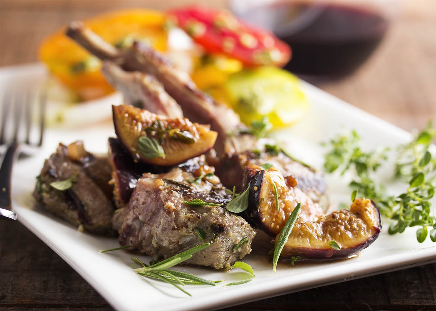 Lamb rib chops are grilled and served with a sauce of fresh figs, port, and balsamic in this simple and elegant main course. | justalittlebitofbacon.com