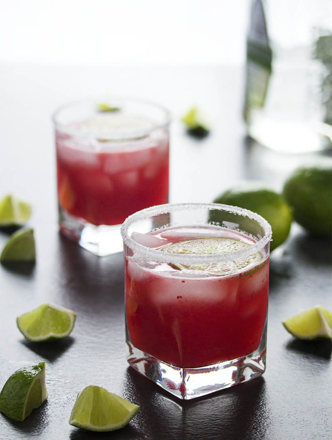 Fresh cranberry sauce is the secret to these intensely flavored tart-sweet fresh cranberry margaritas. Make them by the glass or in a pitcher for parties. | justalittlebitofbacon.com