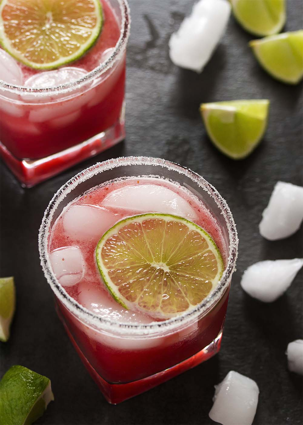 Fresh cranberry sauce is the secret to these intensely flavored tart-sweet fresh cranberry margaritas. Make them by the glass or in a pitcher for parties.   justalittlebitofbacon.com