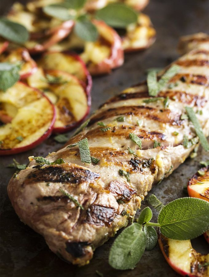 Fall grilling is at its best with this easy grilled pork tenderloin which is paired with grilled apple slices and fresh sage. Yum!   justalittlebitofbacon.com