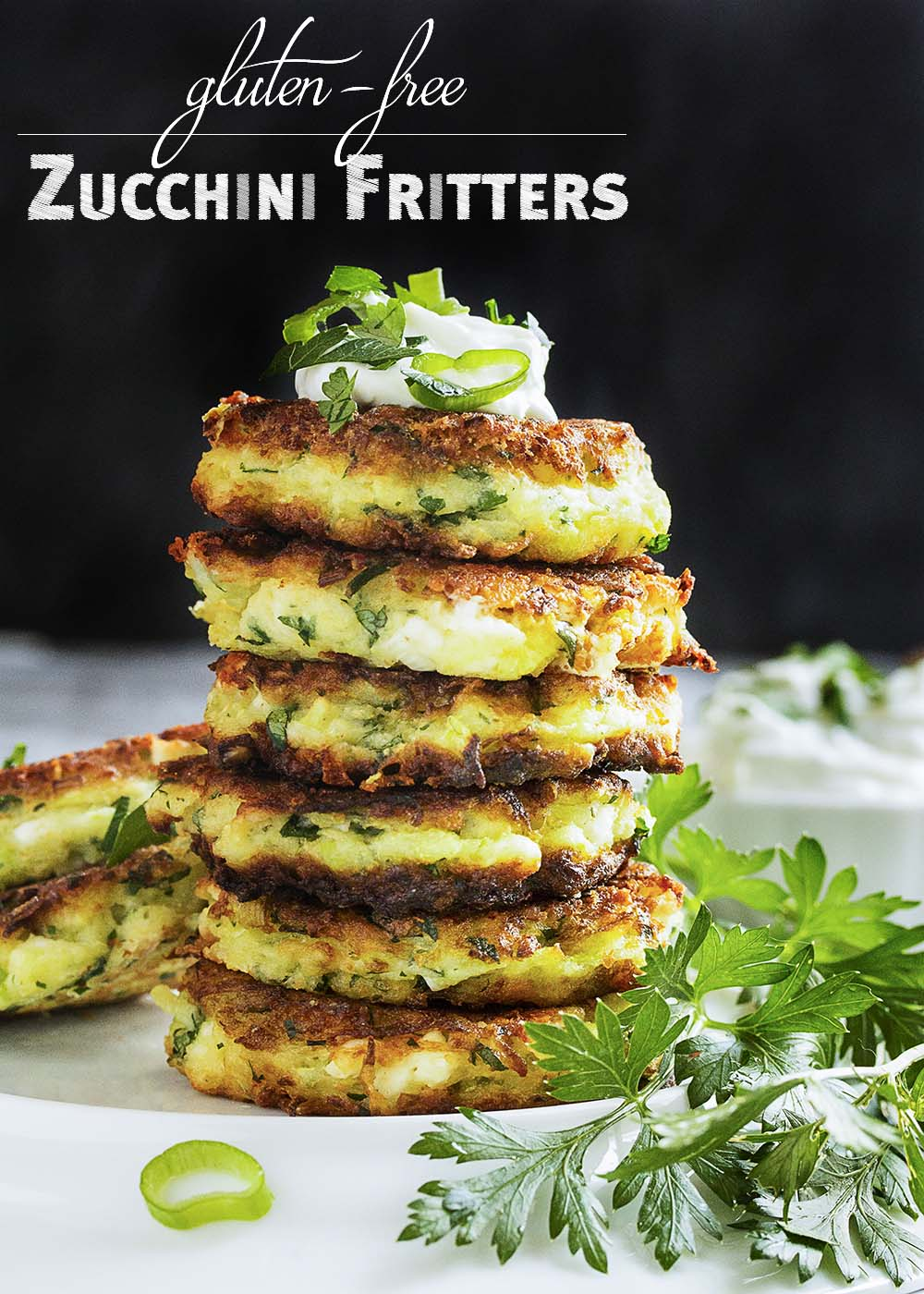 Shredded zucchini, salty feta, rice flour, and fresh parsley are featured in these vegetarian, gluten-free zucchini fritters. | justalittlebitofbacon.com
