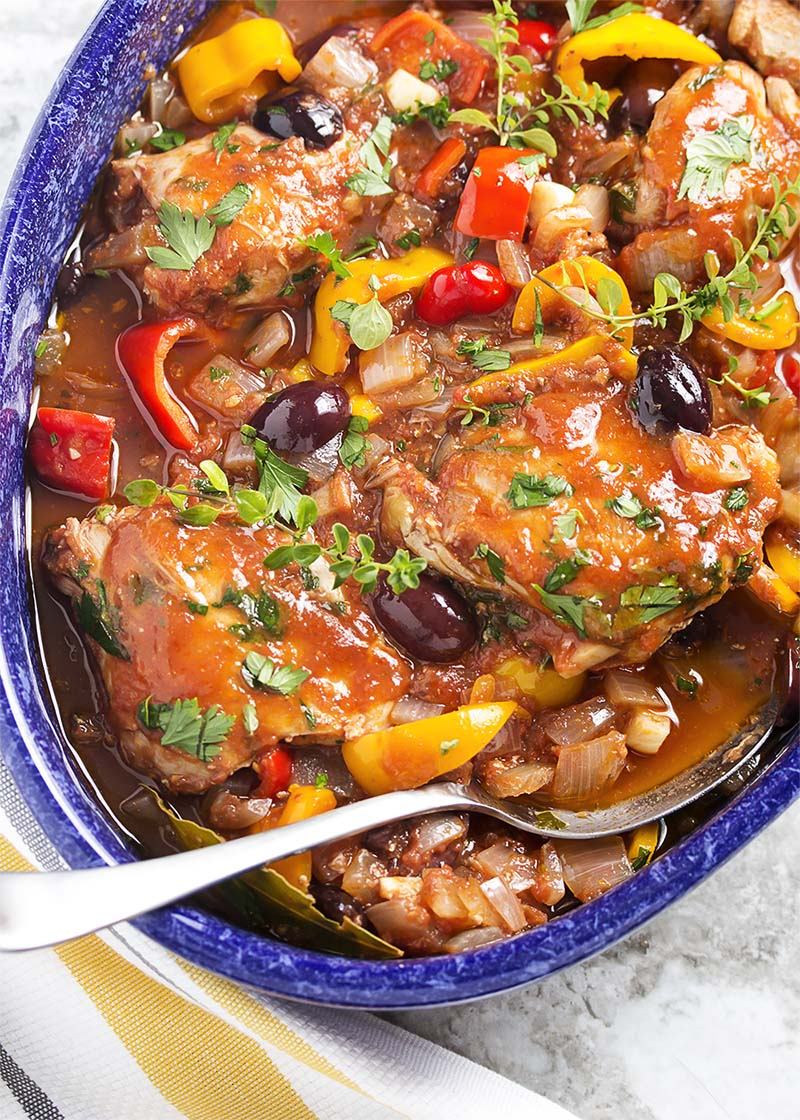 Slow cooker chicken cacciatore is classic Italian comfort food made easy. Put it together in the morning and have dinner in the evening. | justalittlebitofbacon.com