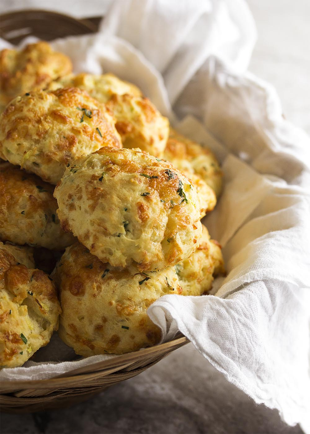 Zucchini cheddar biscuits are soft, tender and full of shredded zucchini and sharp cheddar. Just drop them onto the baking tray and go. | justalittlebitofbacon.com