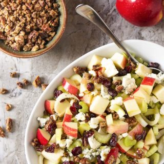 Maple glazed pecans, blue cheese, and diced apples combine with dried cranberries and sliced celery in this fall harvest salad. Great for weeknight dinners and a wonderful side for Thanksgiving. | justalittlebitofbacon.com