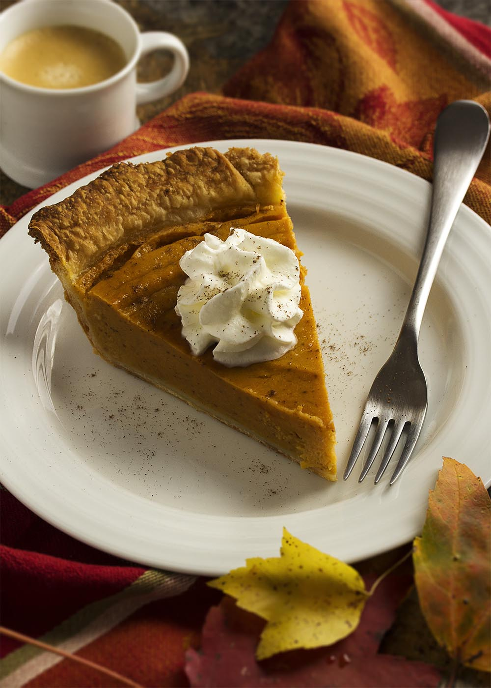 Baked sweet potatoes, cream, spices, and a dollop of bourbon come together to make a classic bourbon sweet potato pie which is perfect for the Thanksgiving table.   justalittlebitofbacon.com