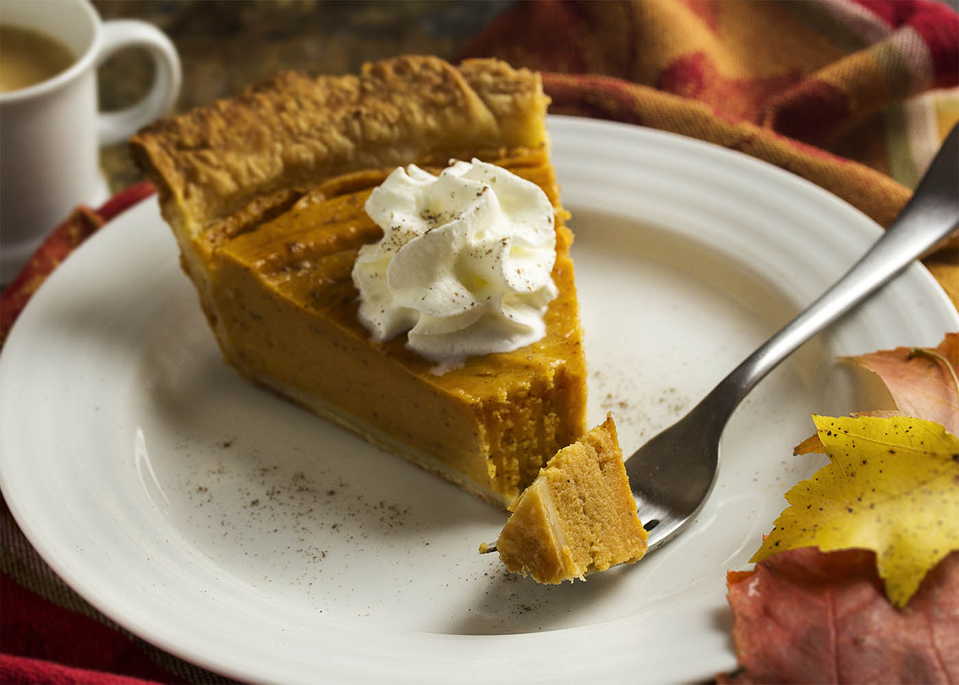 Baked sweet potatoes, cream, spices, and a dollop of bourbon come together to make a classic bourbon sweet potato pie which is perfect for the Thanksgiving table. | justalittlebitofbacon.com