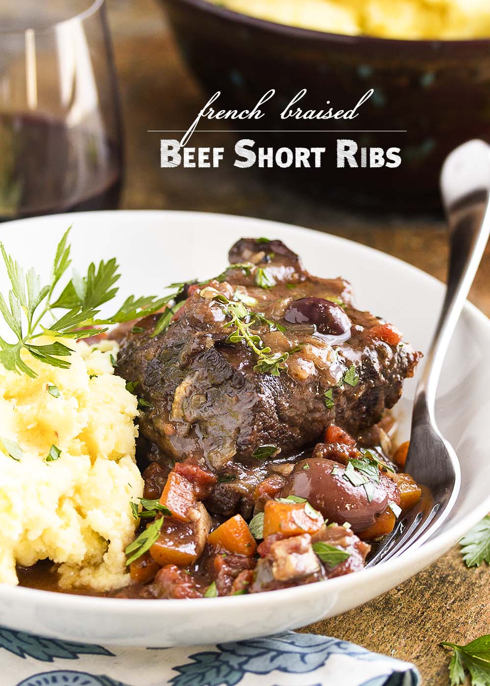 Beef short ribs are browned on the stove top and then oven braised for hours in red wine until they are meltingly tender in this recipe for french short ribs. | justalittlebitofbacon.com
