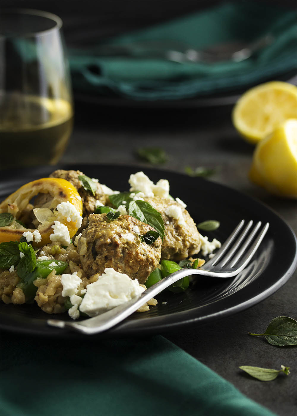 Great and easy one pot meal which starts on the stove and finishes in the oven! Greek lamb meatballs and brown rice is a healthy, complete meal full of the flavors of mint and thyme and finished with a crumble of feta.   justalittlebitofbacon.com