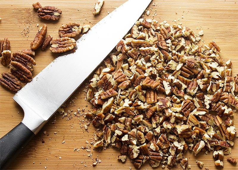 Making glazed pecans for salads and snacks couldn't be easier than with this simple 3-ingredient recipe for maple glazed pecans. | justalittlebitofbacon.com