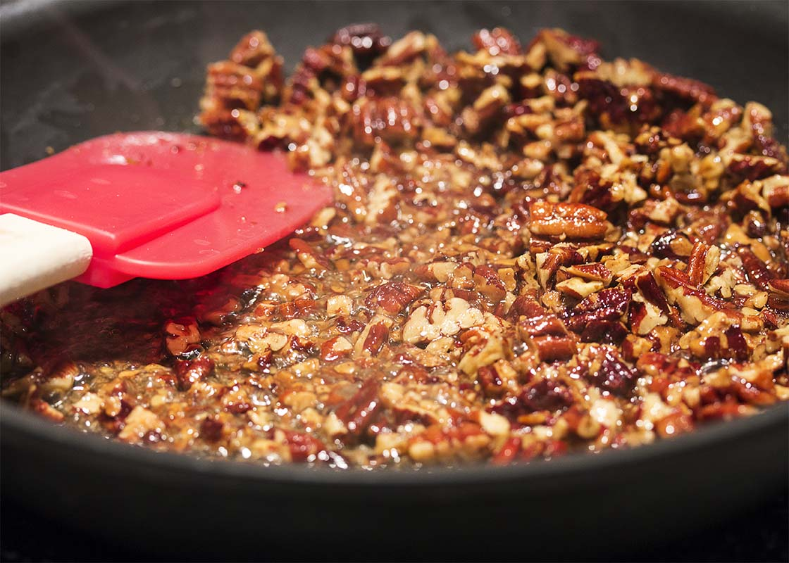 Making glazed pecans for salads and snacks couldn't be easier than with this simple 3-ingredient recipe for maple glazed pecans.   justalittlebitofbacon.com