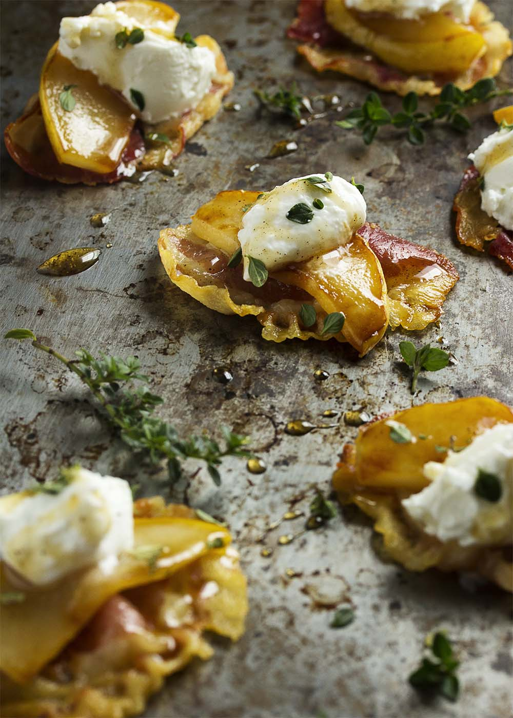 Pear slices and pancetta crisps combine with goat cheese and a drizzle of spiced honey in this unique and simple party appetizer. | justalittlebitofbacon.com