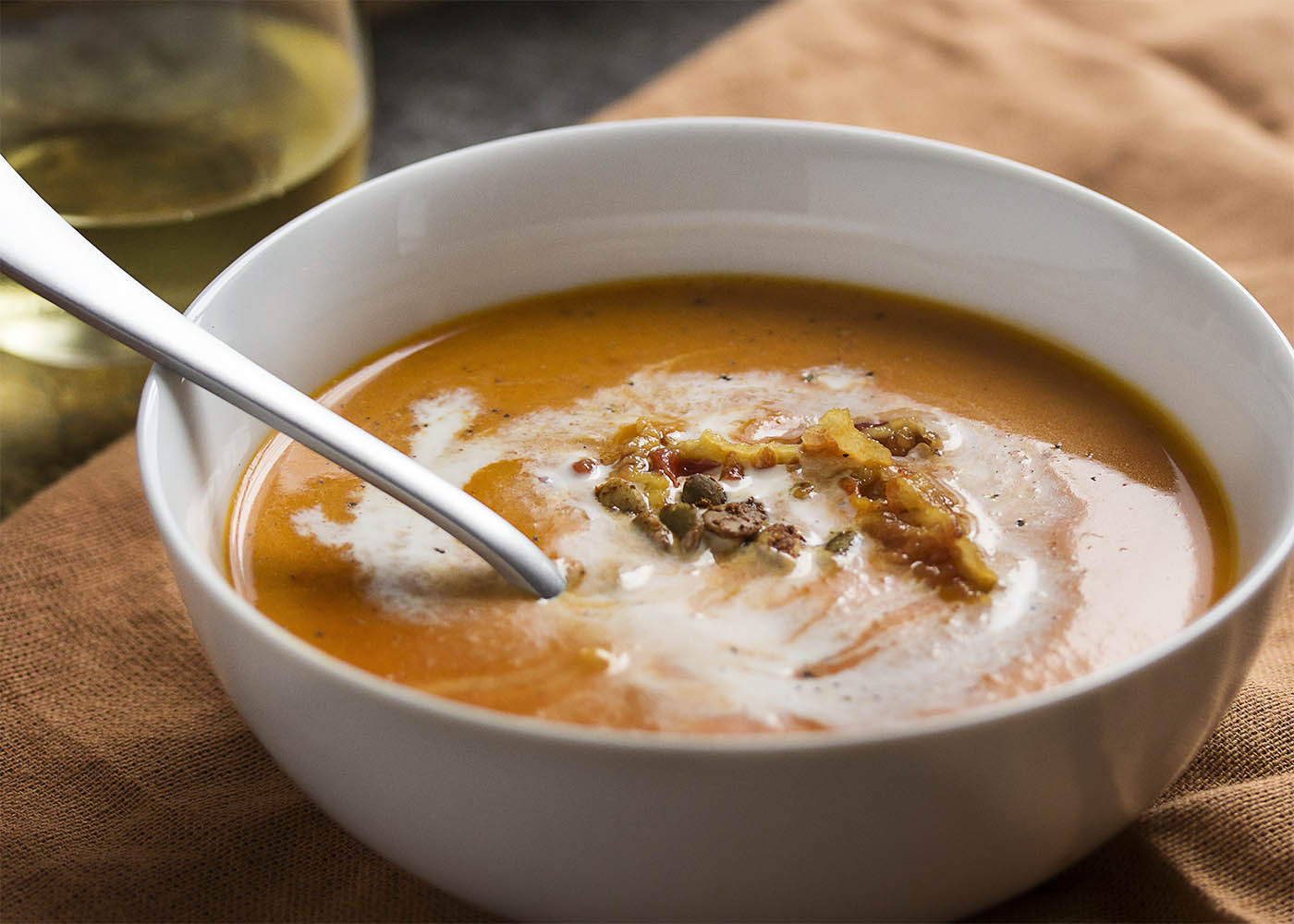 This creamy, spicy roast pumpkin soup is full of Spanish flavors like paprika and roasted red peppers and topped with crispy pancetta.   justalittlebitofbacon.com