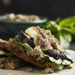 Thick slices of eggplant and halloumi are grilled up and slathered with tapenade mayonnaise in this open faced grilled eggplant sandwich. Great for lunch or for dinner! | justalittlebitofbacon.com