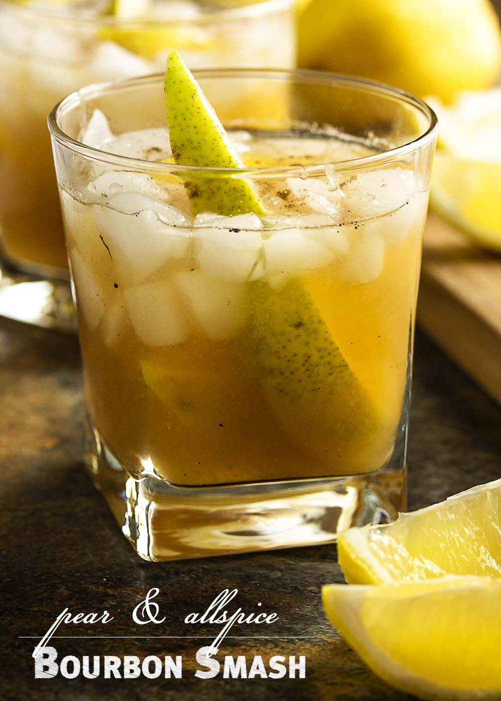 This pear bourbon cocktail smashes together overripe pears with maple syrup, allspice, and bourbon to make a great fall cocktail. | justalittlebitofbacon.com