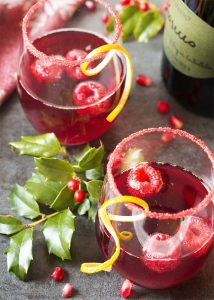 Easy, delicious, and full of bubbles! This pomegranate prosecco cocktail has everything you need for a great holiday drink.   justalittlebitofbacon.com