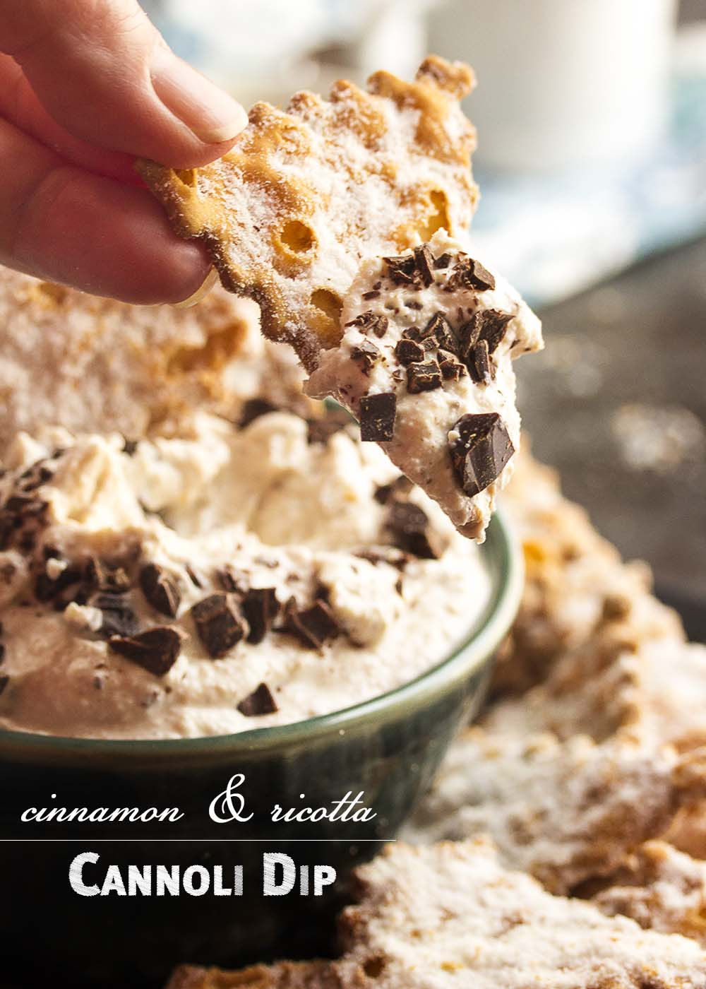 This easy to make ricotta cannoli dip is full of cinnamon and fresh ricotta and topped with chopped chocolate. Perfect for a party! All the yumminess of cannolis without the fuss and bother of making and filling cannoli shells. | justalittlebitofbacon.com