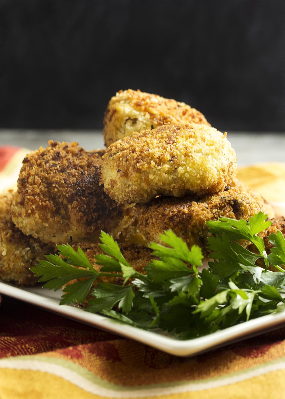 Turkey stuffing croquettes with a cranberry vinaigrette are a great way to transform your Thanksgiving and holiday leftovers into a new meal!   justalittlebitofbacon.com