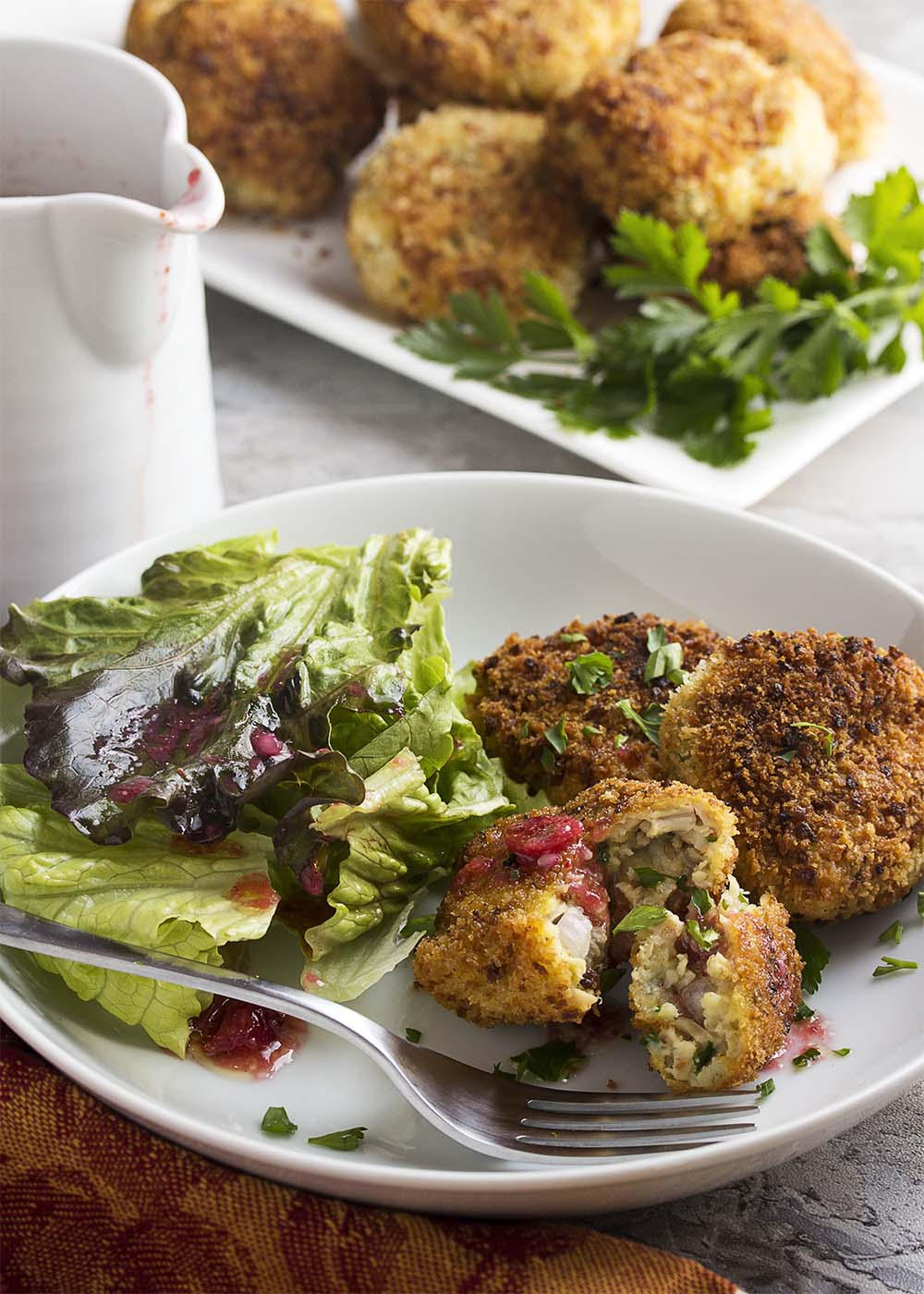 Turkey stuffing croquettes with a cranberry vinaigrette are a great way to transform your Thanksgiving and holiday leftovers into a new meal! | justalittlebitofbacon.com