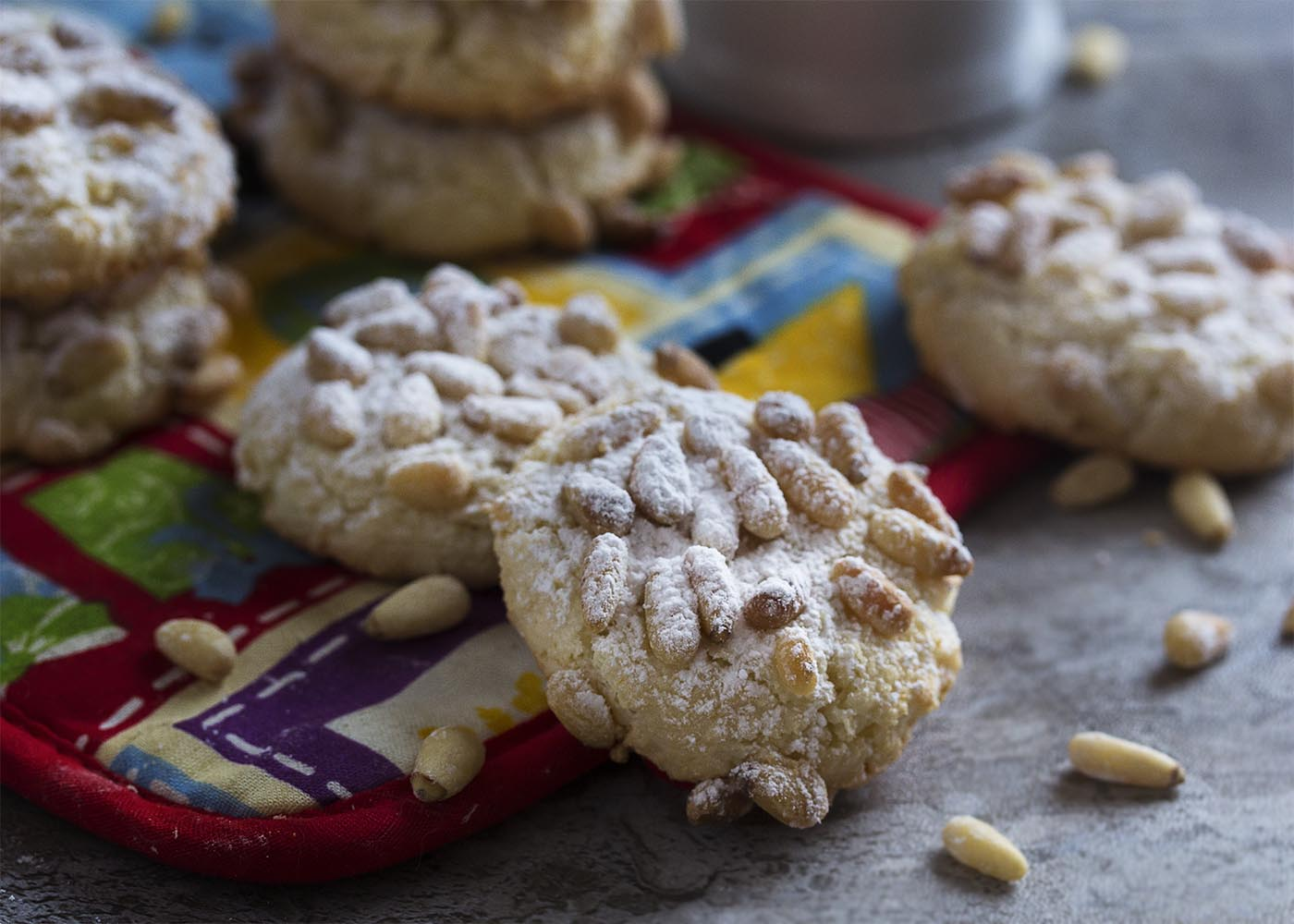 These gluten-free Italian pignoli cookies, adapted from Lidia Bastianich, are a great holiday cookie full of almonds and pine nuts! A great addition to a Christmas cookie tray. | justalittlebitofbacon.com