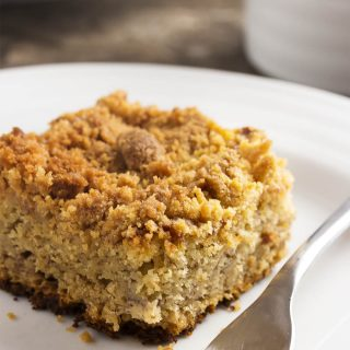 This easy moist banana cake with a buttery crumb topping is a great way to use up those overripe black bananas on your counter! | justalittlebitofbacon.com