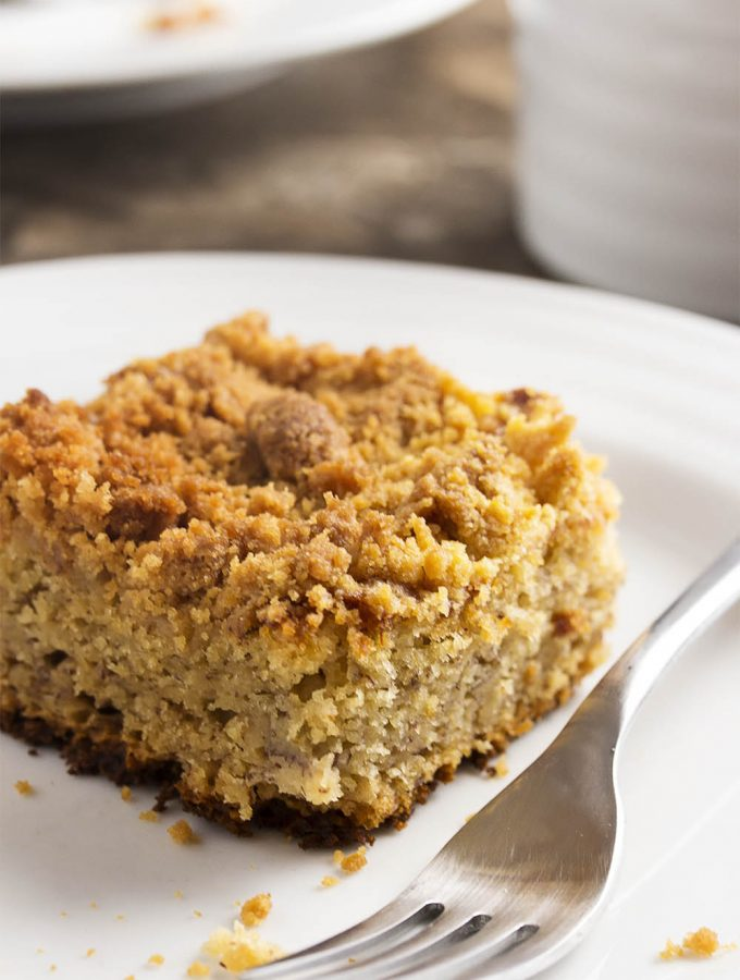 This easy moist banana cake with a buttery crumb topping is a great way to use up those overripe black bananas on your counter!   justalittlebitofbacon.com