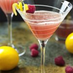 This blushing meyer lemon drop is a martini with a twist! Vodka is mixed with floral Meyer lemon juice and spiked with a bit of raspberry liqueur to make a great sweet and sour cocktail. | justalittlebitofbacon.com