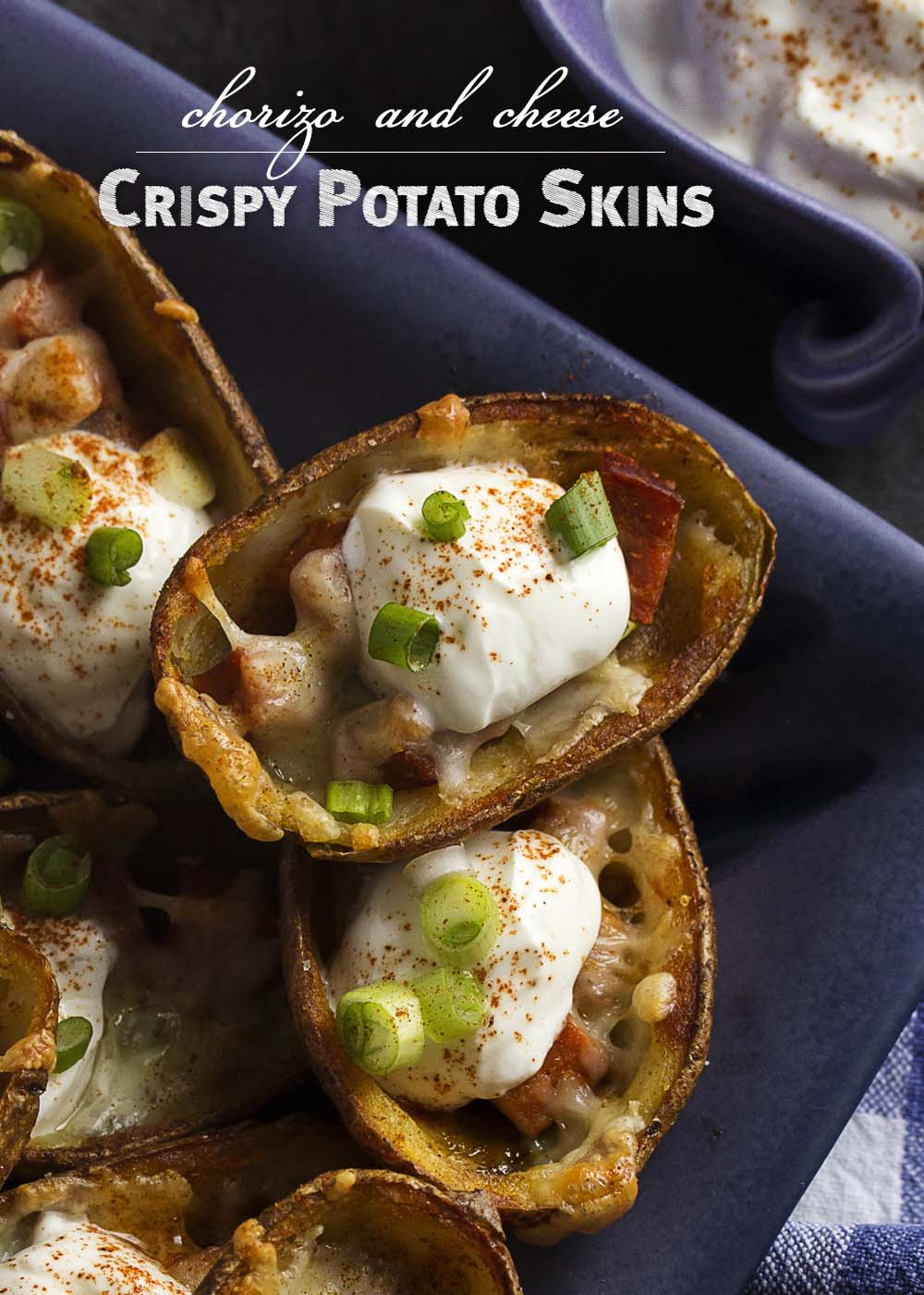 These crispy potato skins are brushed with bacon fat and browned before being filled with chorizo and manchego cheese for a great party appetizer. | justalittlebitofbacon.com