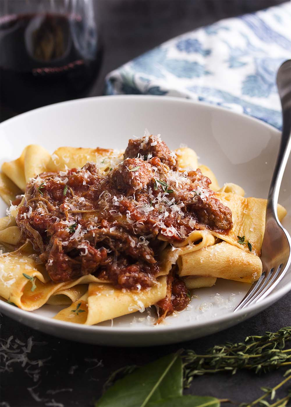 Italian comfort food of tomato, braised sausage, and pork shoulder ragu simmering on the stove is the perfect way to spend a chilly day. This pork ragu is easily doubled and freezes well. | justalittlebitofbacon.com