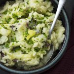 This recipe for creamy buttermilk garlic mashed potatoes topped with chives is super easy comfort food great for holidays or any day. | justalittlebitofbacon.com