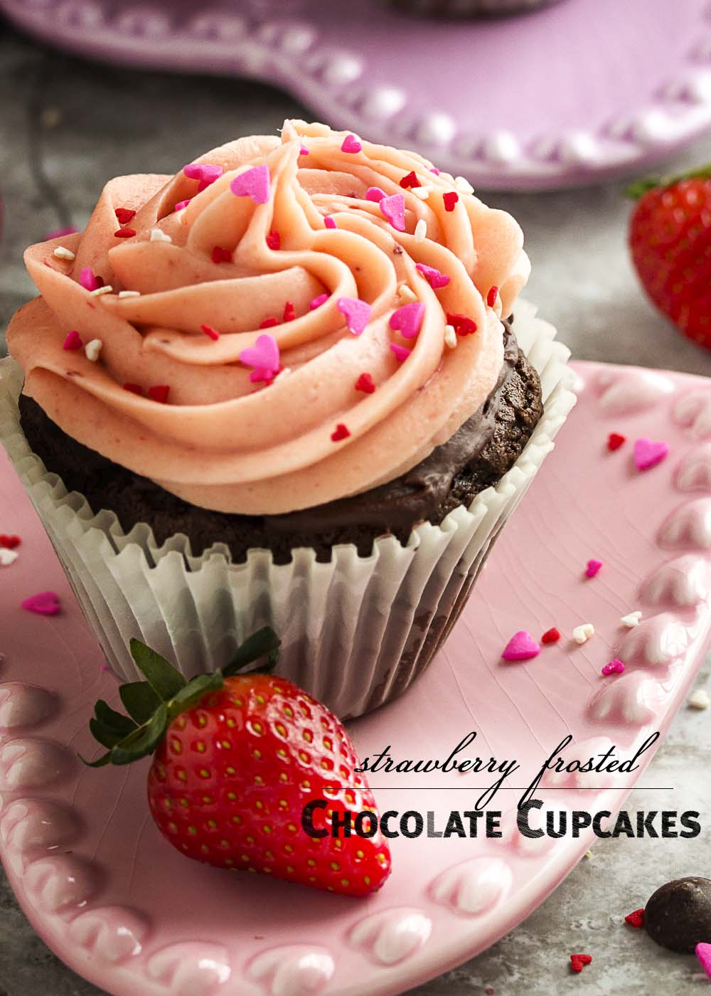 Rich, dark double chocolate cupcakes are filled with chocolate ganache and frosted with a strawberry buttercream frosting in this very chocolaty way to say I Love You this Valentine's Day. | justalittlebitofbacon.com