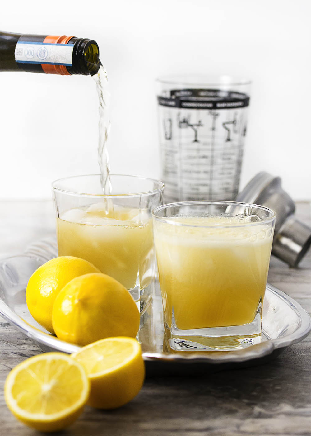 Pull out the Meyer lemons to give this classic NoLa cocktail a twist as you celebrate Fat Tuesday (or any day) with a cognac French 75. | justalittlebitofbacon.com