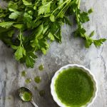 This parsley infused olive oil is a quick condiment which is wonderful drizzled over soups, bruschetta, grilled foods, and more! | justalittlebitofbacon.com