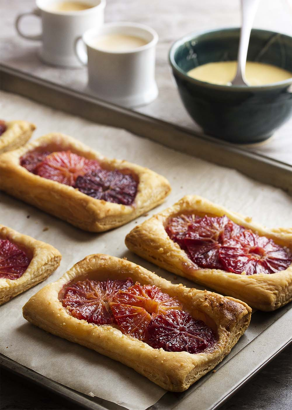 Looking for an easy but impressive dessert? Puff pastry and blood oranges make these orange galettes both beautiful and a snap to bake. | justalittlebitofbacon.com