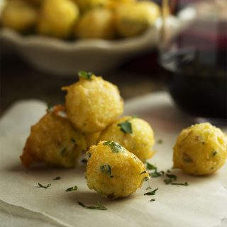 Light, fluffy, and crispy! These Spanish salt cod croquettes with aioli are bite-sized fish fritters perfect for a tapas party. | justalittlebitofbacon.com