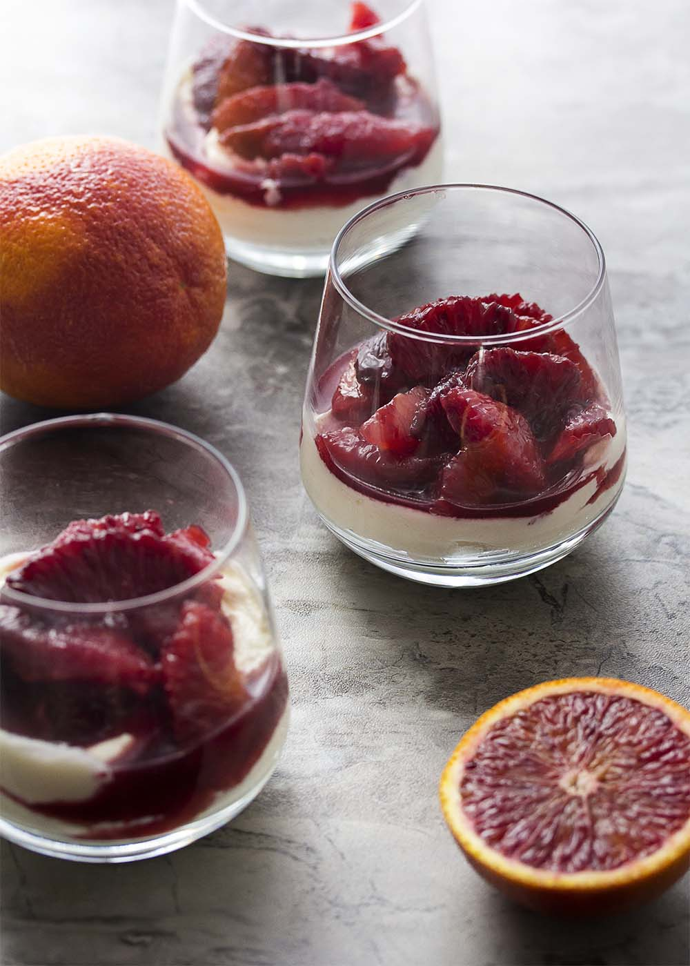 Ruby red and cinnamon spiced, this blood orange compote is a beautiful and intensely flavored sauce perfect for spooning over creamy mascarpone mousse. | justalittlebitofbacon.com