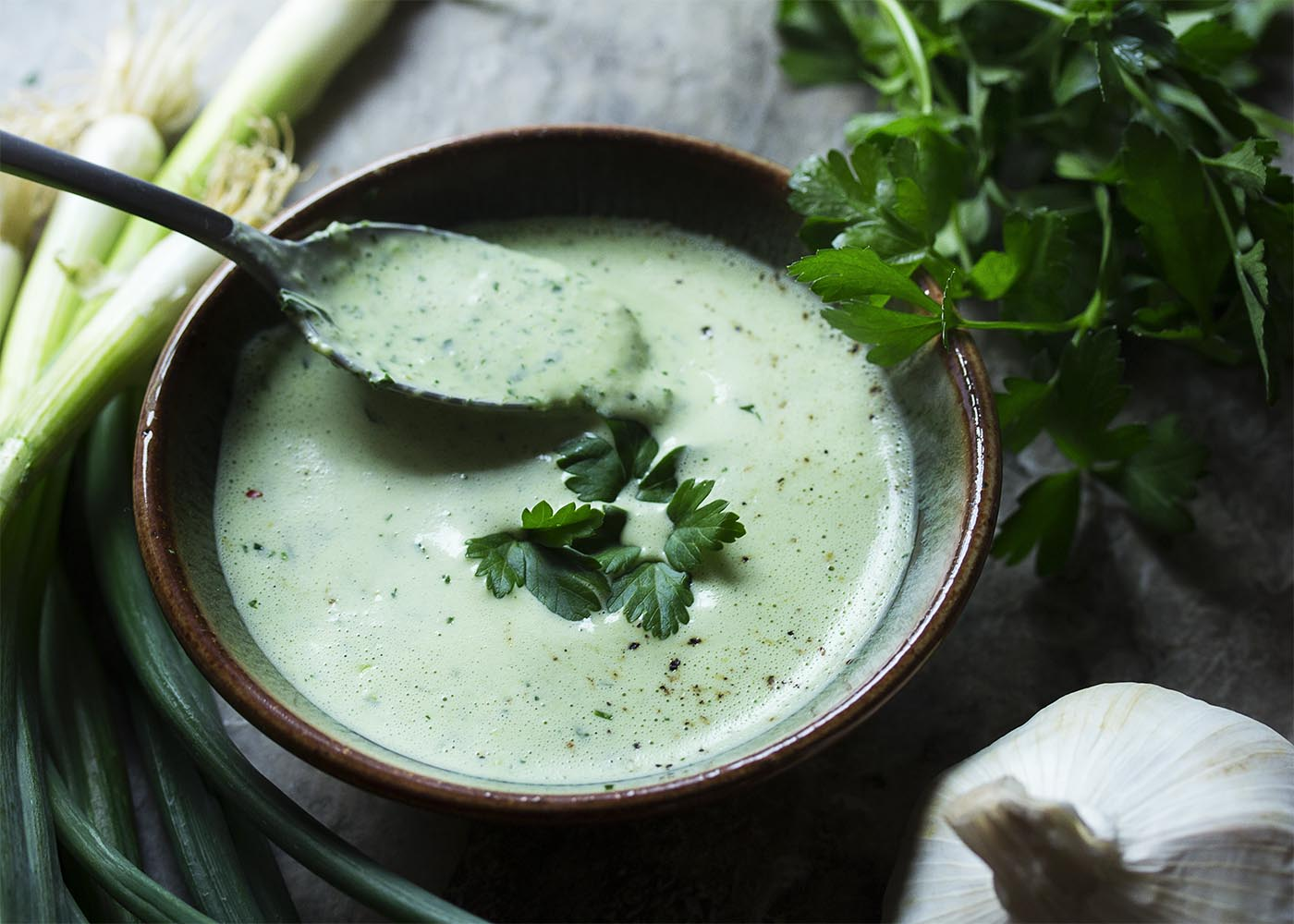 Jalapenos and scallions give this versatile green goddess buttermilk dressing a little kick and buttermilk gives it a great tang. Use it as a dressing for salads, a sauce for seafood and chicken, or as a dip! | justalittlebitofbacon.com