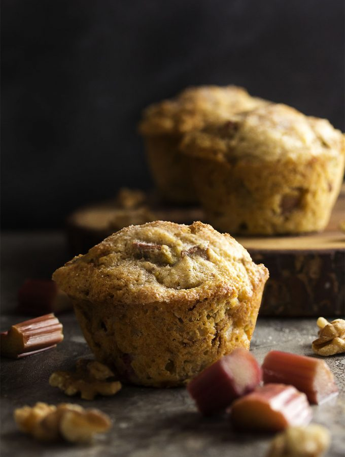 These rhubarb muffins are packed full of fruit and toasted walnuts and then sprinkled with cinnamon sugar to make a great, family-pleasing breakfast. | justalittlebitofbacon.com