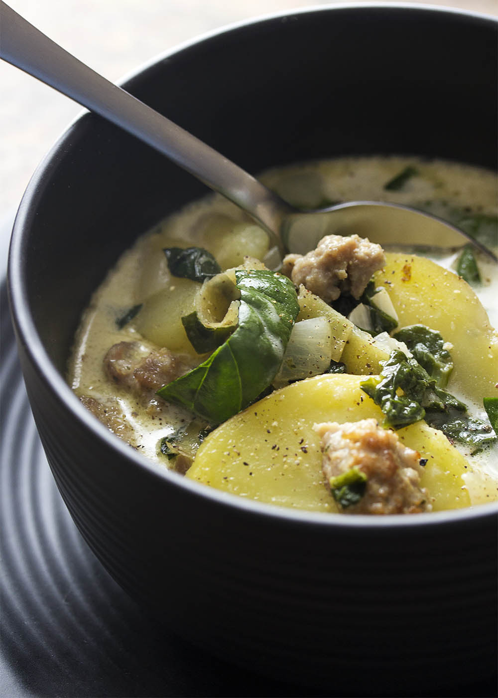 Love Olive Garden's zuppa toscana and want to make it at home? I've adapted the recipe to create a slow cooker zuppa toscana perfect to make on busy days! | justalittlebitofbacon.com